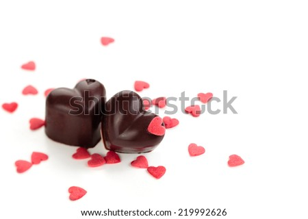 Homemade chocolate candies decorated with heart shaped sprinkles.  - stock photo