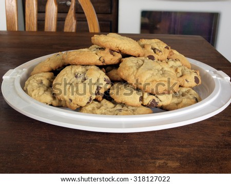 homemade chocolate chip cookies fresh baked on a serving tray - stock photo