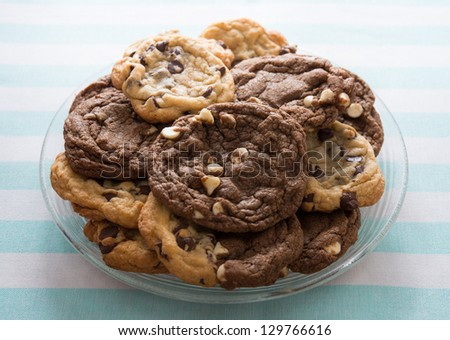 Homemade chocolate chips cookies on a plate with a white and blue background. Sweet food. - stock photo