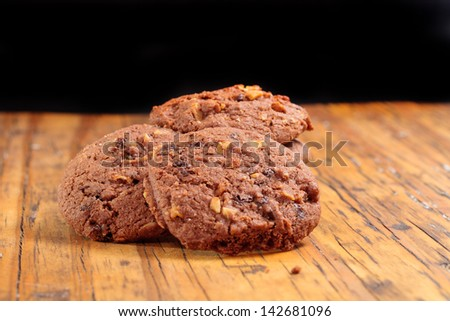 Homemade Chocolate cookies on a wooden plank