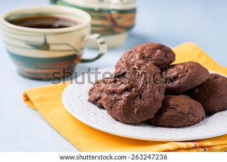 Homemade chocolate cookies on white plate, selective focus - stock photo