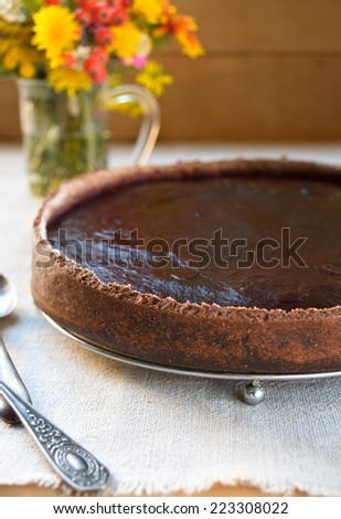 Homemade chocolate cream tart with blackberry jelly and walnuts - stock photo