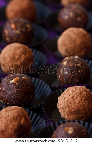 Homemade chocolate truffle on a dark background.