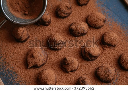 Homemade Chocolate Truffles Sprinkling With Cocoa - stock photo