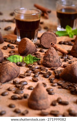 Homemade chocolate vanilla and coffee truffles with glass of coffee. - stock photo