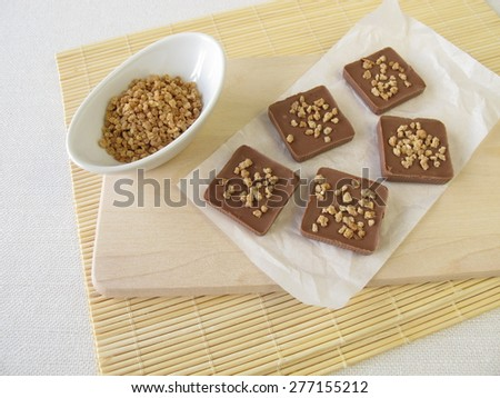 Homemade chocolate with almond brittle - stock photo
