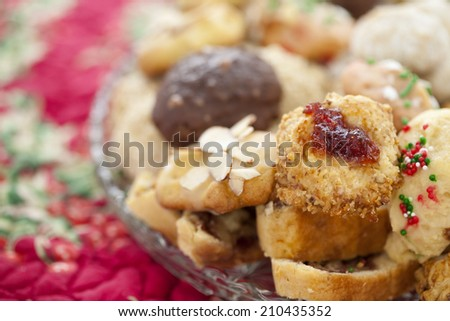 Homemade Christmas Cookies arranged on a plate. Shallow depth of field. - stock photo