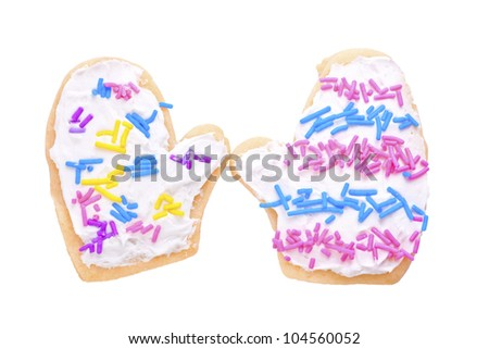 Homemade Christmas cookies decorated and in the shape of mittens. - stock photo