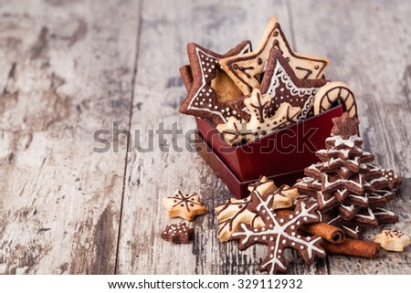 Homemade christmas cookies on wooden table - stock photo