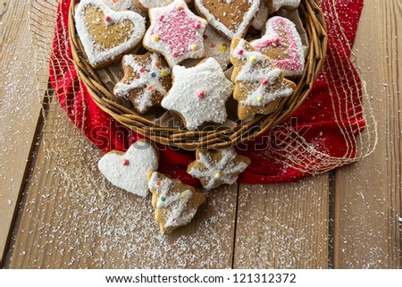 Homemade christmas cookies with decoration on wooden table - stock photo