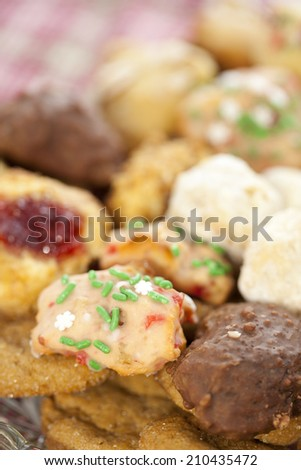 Homemade Christmas cookies with sprinkles. Shallow depth of field. - stock photo