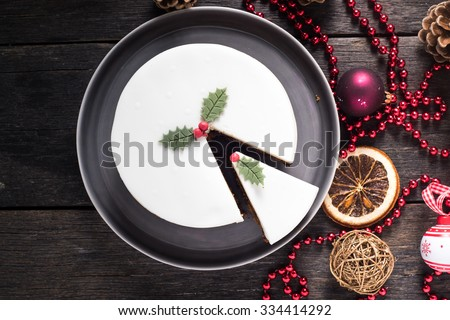 Homemade Christmas fruit cake, on decorated table - stock photo