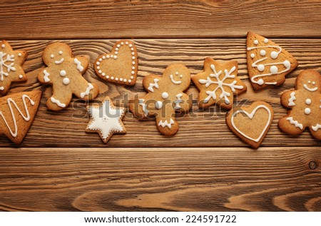homemade christmas gingerbread cookies on wooden background - stock photo