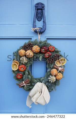 Homemade Christmas Wreath Hanging On Blue Door - stock photo