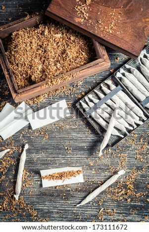 Homemade cigarettes made �¢??�¢??with tobacco - stock photo