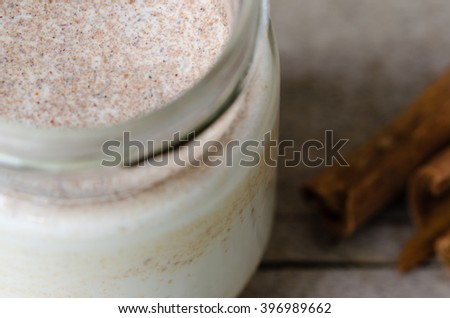 Homemade cinnamon yogurt, rustic background, closeup view.