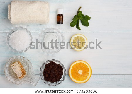 Homemade coffee scrub with sea salt, honey, cream base, lemon, orange, essential oil, mint - stock photo