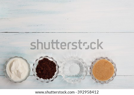 Homemade coffee scrub with yogurt, coconut oil,sugar, top view, flat lay - stock photo
