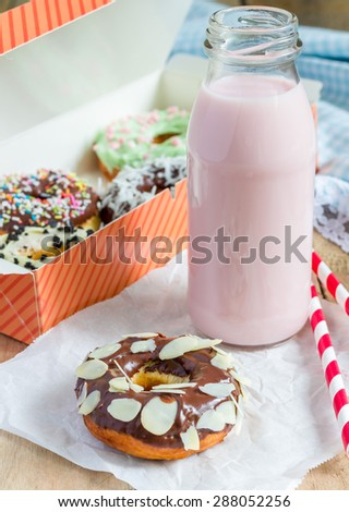 Homemade colorful donuts with strawberry milk drink - stock photo