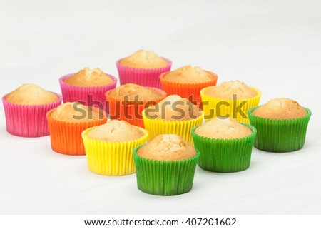 Homemade Colorful Plain Cupcakes On White Table