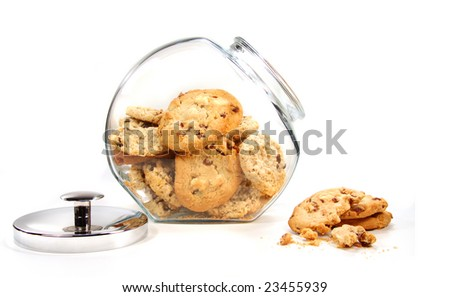 Homemade cookies in glass jar on white background - stock photo