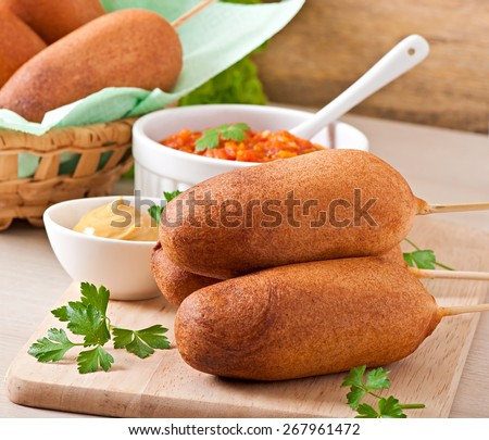 Homemade corn dogs with sauces - stock photo