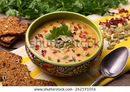 Homemade cream soup from baked butternut squash with thyme and paprika with parsley - stock photo