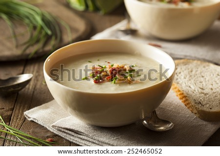 Homemade Creamy Potato and Leek Soup in a Bowl - stock photo