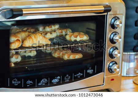 Homemade croissants and mini waffles in the electric oven.