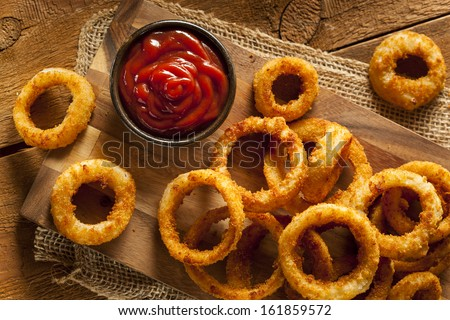 Homemade Crunchy Fried Onion Rings with Ketchup - stock photo