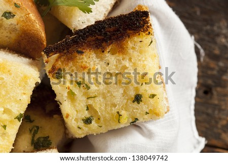 Homemade Crunchy Garlic Bread with butter and parsley - stock photo