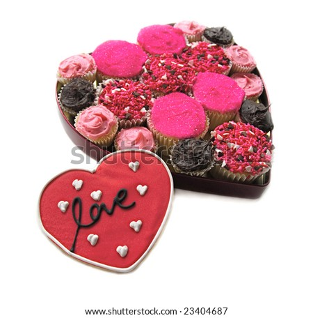 Homemade Cupcakes in heart shaped box with Love Cookie - stock photo