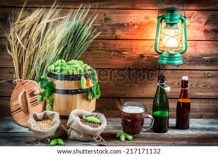Homemade dark beer made of malt and hops - stock photo