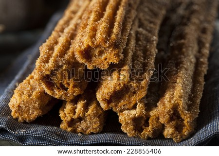 Homemade Deep Fried Churros with Cinnamon and Sugar - stock photo