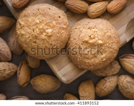 Homemade delicious cookies biscotti with almonds on the table. horizontal top view from above. Dark and moody style.  - stock photo