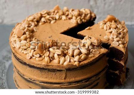 homemade delicious vegan peanut and chocolate cake  - stock photo