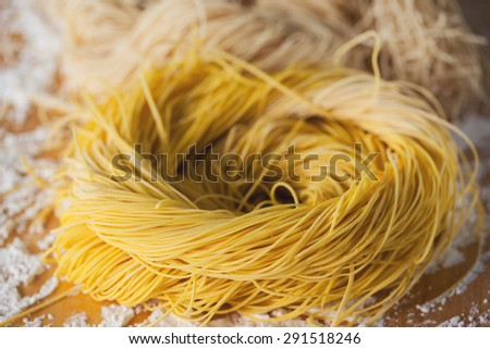 homemade dried chinese noodles roll - stock photo