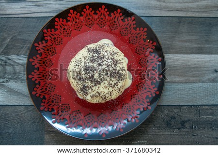 Homemade dumpling with vanilla icing and poppy seed - stock photo