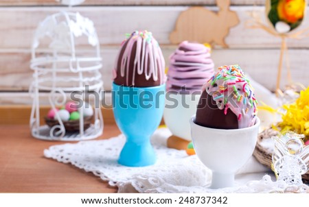Homemade easter chocolate eggs with glaze and sprinkles - stock photo