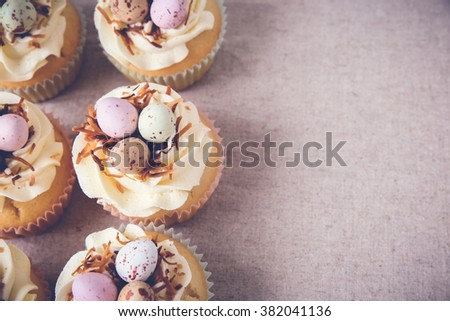 Homemade Easter eggs cupcakes, copy space background,toning - stock photo