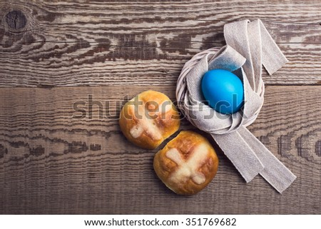 Homemade Easter hot cross buns and eggs on wooden table, top view - stock photo