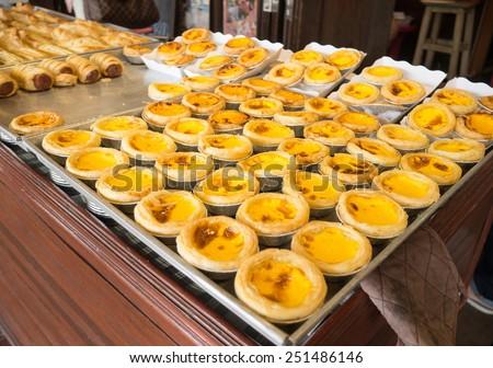 homemade egg tart and Portuguese custard tart at  Ampawa, Samut Songkram,Thailand ( Ampawa is popular water market in Thailand ) - stock photo
