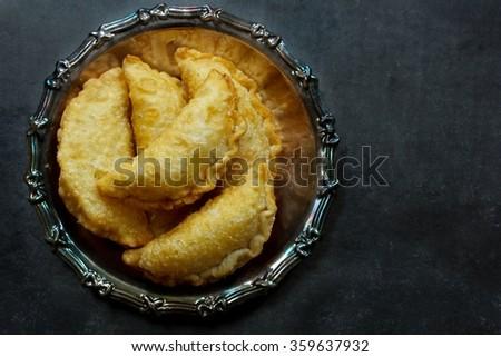 Homemade Empanadas top view on dark background - stock photo