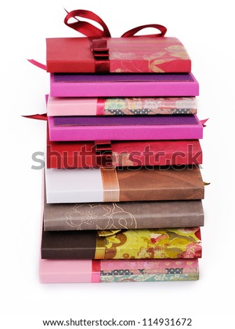 homemade exclusive DVD Cases in stack on a white background - stock photo