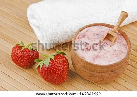 Homemade facial mask of strawberry and cream - stock photo
