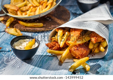Homemade Fish & Chips and sauce - stock photo