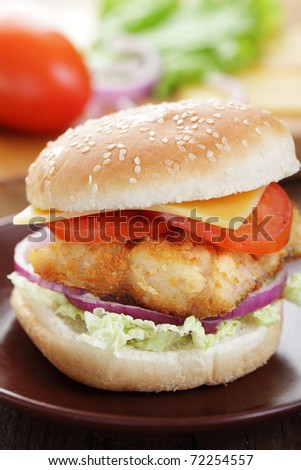 Homemade fishburger on the brown plate - stock photo