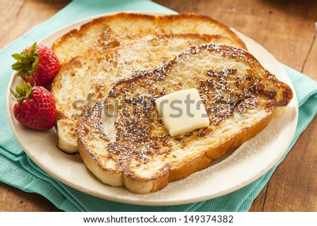 Homemade French Toast with Butter and Powdered Sugar - stock photo