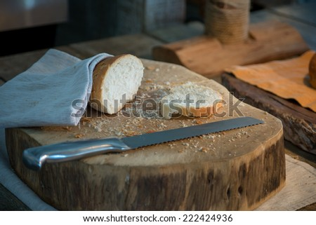 Homemade fresh bread on wooden table, selective focus - stock photo