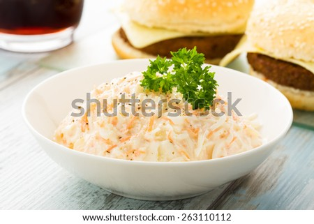 homemade fresh coleslaw served in a small bow. - stock photo